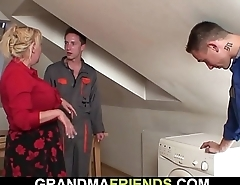 Two workers screw busty blonde grandma