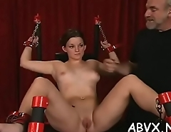 Nude woman stands and endures coarse bondage non-professional