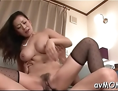 Milf hottie strokes and fondles her wet cunt on web camera