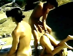 Cute blondes Katie Gold and Shay Sweet are taking sunbaths naked when two dudes came with special proposition